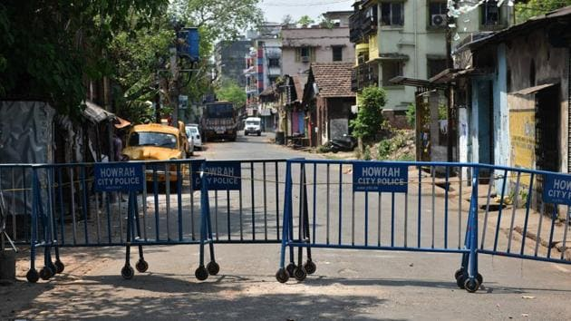 Barricades placed by Howrah Police at identified coronavirus hotspots on day eighteen of the 21-day nationwide lockdown, at Foreshore Road in Howrah, West Bengal on Saturday.(PTI File Photo)