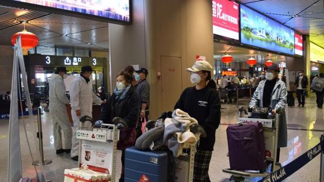 Passengers wearing face masks push luggage carts at an airport in Harbin, capital of Heilongjiang province bordering Russia, as the spread of the novel coronavirus disease continues in China.(Reuters Photo)