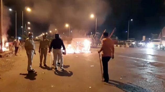 Police force and Rapid action force deployed after migrant workers clashed with security personnel in Surat on Friday.(ANI)