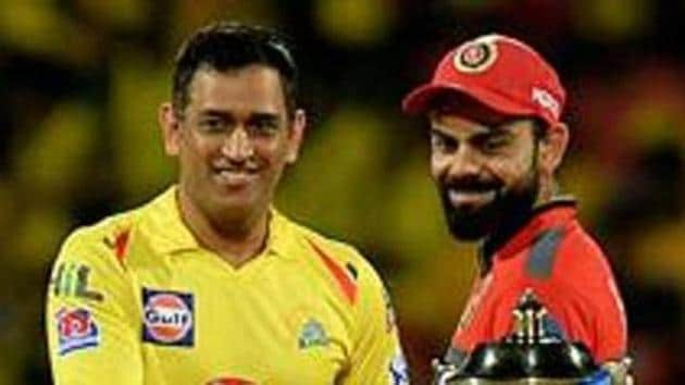(FILES) In this file photo taken on March 24, 2019, Chennai Super Kings cricket captain Mahendra Singh Dhoni and Royal Challengers Bangalore cricket captain Virat Kohli (R) gesture beside IPL trophy ahead of the Indian Premier League (IPL) Twenty20 cricket match between Chennai Super Kings and Royal Challengers Bangalore at the M. A. Chidhambaram Stadium in Chennai.(AFP)