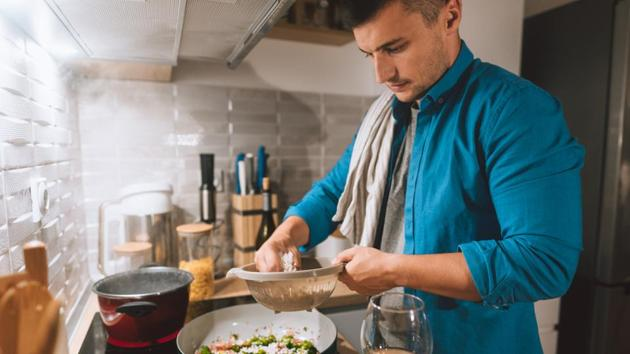 While binge watching on OTT platforms is the favourite pass time of most youngsters, the cooking challenge has made them take a break from screen time and get involved in cooking for the household.(Getty Images)