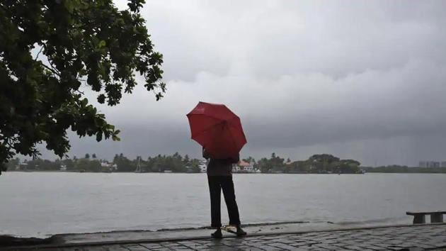 A man stands by the sea as it drizzles in Kochi in Kerala on May 28, 2018.(AP File Photo)