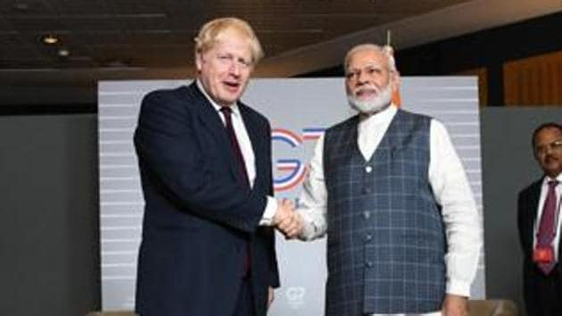 Britain's Prime Minister Boris Johnson with Prime Minister Narendra Modi at a bilateral meeting during the G7 summit in France in August, 2019.(Reuters Photo)