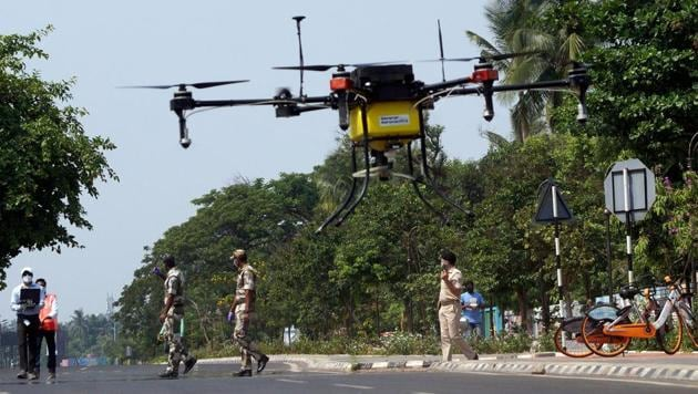 Municipal workers using a drone to spray disinfectant in Bhubaneswar.(ANI)