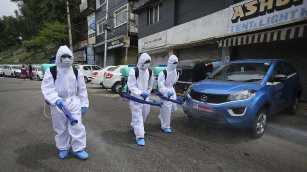 Municipal workers disinfect an area during lockdown to prevent the spread of new coronavirus in Jammu, on April 16.(AP)
