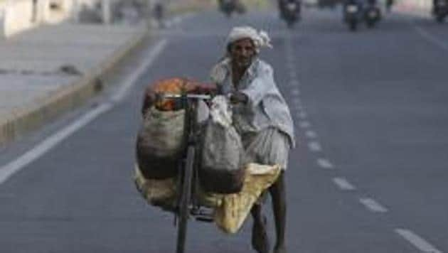 An Indian man carries vegetables on a bicycle in Hyderabad, India, Friday, March 27, 2020.(AP)