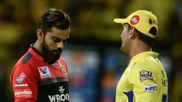 Chennai Super Kings cricket captain Mahendra Singh Dhoni (L) shakes hands with Royal Challengers Bangalore cricket captain(AFP)
