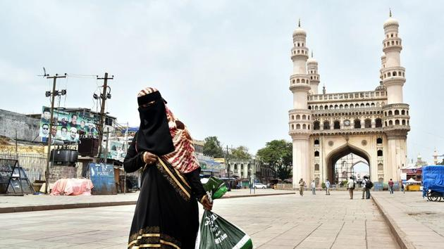 A woman walks past the Charminar during the lockdown amid Covid-19 pandemic, in Hyderabad.(ANI File)