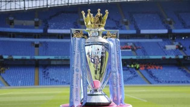FILE - In this Sunday, May 6, 2018 file photo the English Premier League trophy sits on the pitch prior to the English Premier League soccer match between Manchester City and Huddersfield Town at Etihad stadium.(AP)