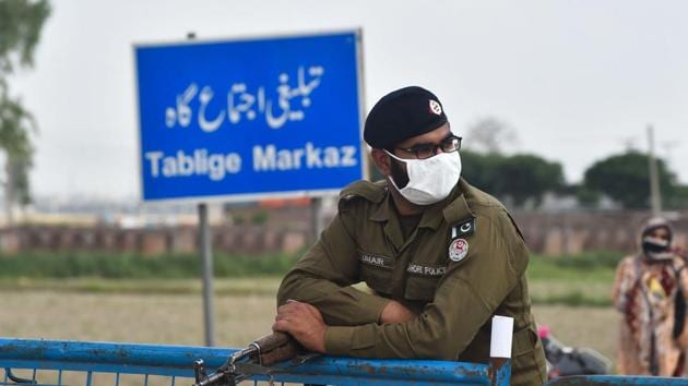 A policeman wearing a facemask stands at the Tablighi Markaz checkpoint during a government-imposed nationwide lockdown as a preventive measure against the COVID-19 coronavirus, in Lahore.(AFP)