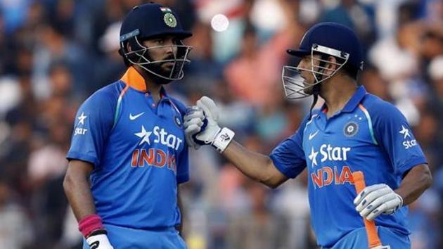 Yuvraj Singh celebrates with MS Dhoni.(Arjun SIngh/ BCCI/ SPORTZPICS)