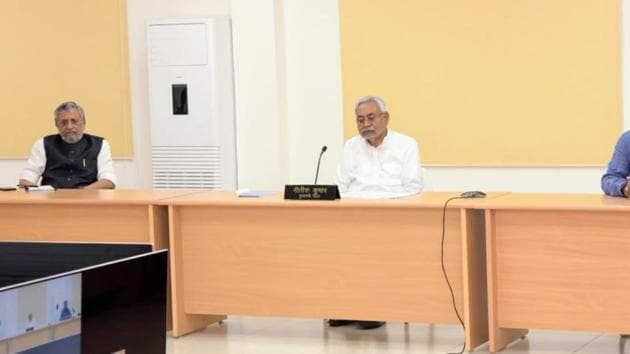Chief minister Nitish Kumar with Dy CM Shushil Mody holding Video conferencing with DMs and SPs during nationwide lockdown amid the coronavirus (COVID-19) pandemic in Patna(HT File)