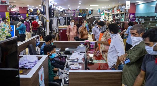 Shoppers in an electronic goods showroom in Kozhikodein Kerala that now opens once a week.(PTI)
