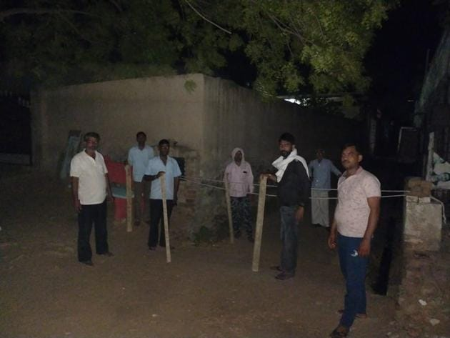 Villagers maintaining vigil to keep check on movement at a village in Haryana's Rewari district.(HT PHOTO)