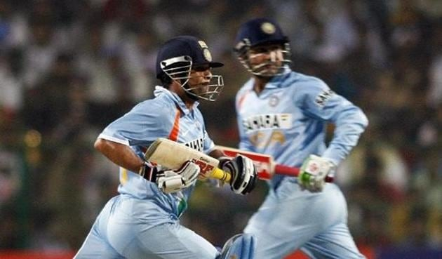 Indian cricketers Sachin Tendulkar (L) and Virendra Sehwag run between the wicket during the fourth One Day International(AFP)