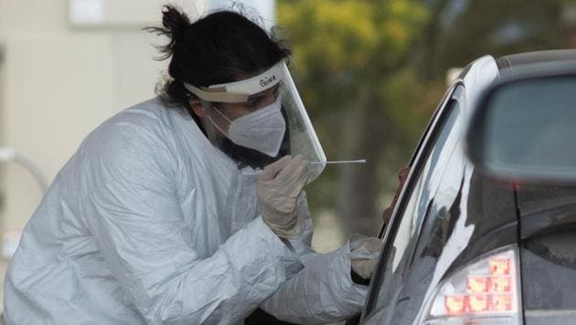 A medical professional conducts tests for the coronavirus disease in Bolinas, a coastal enclave in Northern California where all residents are being tested for the novel coronavirus and its antibodies, one of the first such efforts since the pandemic hit the United States three months ago, in Bolinas, California.(Reuters Photo)