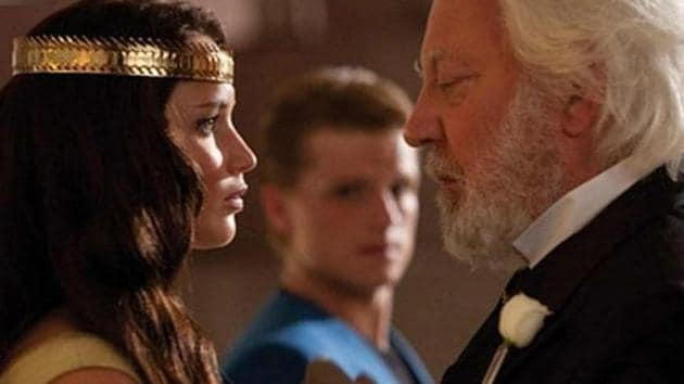 Jennifer Lawrence as Katniss and Donald Sutherland as President Snow.