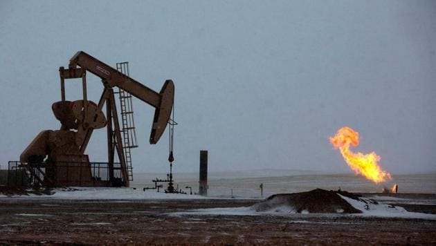 Natural gas flares are seen at an oil pump site outside of Williston, North Dakota.(Reuters File Photo)