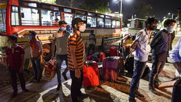 Stranded students from Kota alight the bus arranged by UP government as they arrive at their native place during the nationwide lockdown, imposed as a preventive measure against the coronavirus, in Prayagraj, Monday, April 20, 2020.(PTI)