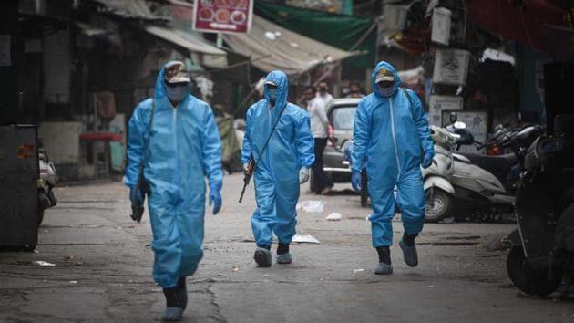 Paramilitary staff wearing Personal Protective Kits patrolling inside contaminated zones .(HT Photo/Sanchit Khanna)