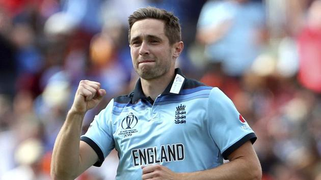 England's Chris Woakes celebrates the dismissal of India's Rohit Sharma during the Cricket World Cup.(AP)
