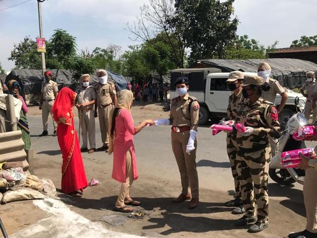 Initially hesitant, women later came forward to take the pads handed out by Punjab Police personnel and volunteers of an NGO, on Monday in Mohali.