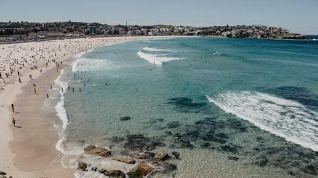 Dozens of eager surfers jumped railings and hit the water even before the beach officially opened at 7 am, five weeks after police sealed the area off because of large crowds ignoring social distancing orders.(Unsplash)