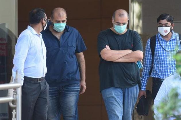 The duo was produced before a special Prevention of Money Laundering Act (PMLA) court, which remanded them to ED's custody till May 24.(Vijayanand Gupta/HT file Photo)