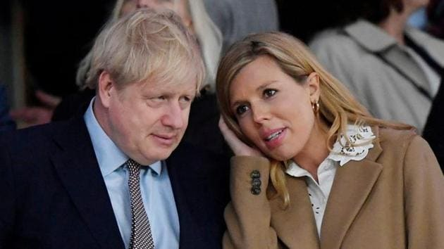 FILE PHOTO: Britain's Prime Minister Boris Johnson with his partner Carrie Symonds.(REUTERS)