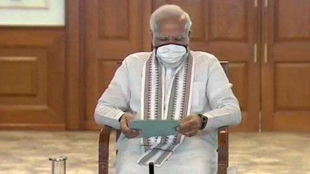 PM Modi at the meeting with ministers. (Photo by ANI)