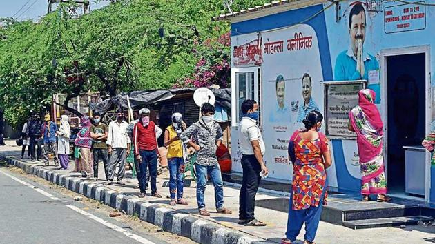 People queue outside a mohalla clinic in Vasant Kunj. Small hospitals, dispensaries and mohalla clinics are providing health care to patients with health problems other than Covid-19.