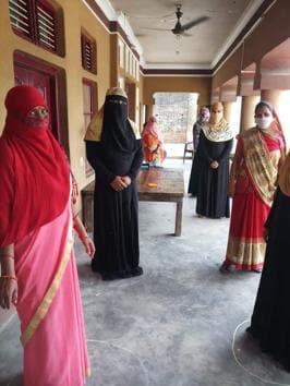Women waiting for rations following social distancing in a Barabanki village in Uttar Pradesh.(HT Photo)