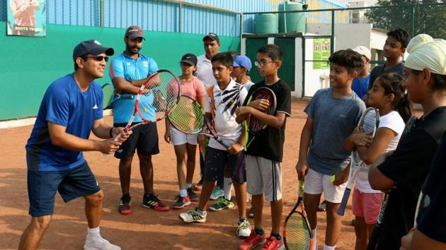 Coach Gaurav Chadha and former Davis cupper Harsh Mankad during a tennis camp at Roots Tennis Academy in Zirakpur. Chadha runs three centres in the tricity and is facing financial heat due to the lockdown.(HT File Photo)