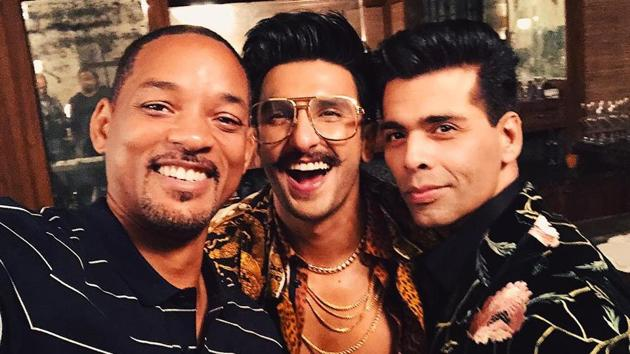Will Smith poses with Ranveer Singh and Karan Johar during a recent visit to India.