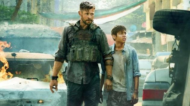 Chris Hemsworth and Rudhraksh Jaiswal in a poster for Extraction.