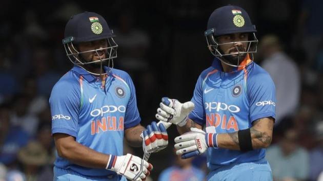 India captain Virat Kohli, right, and India's Suresh Raina(AP)