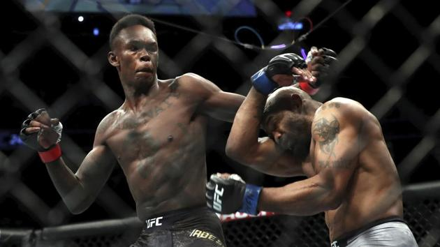 UFC middleweight champion Israel Adesanya of Nigeria and Yoel Romero of Cuba mix it up during UFC 248 at T-Mobile Arena in Las Vegas.(AP)