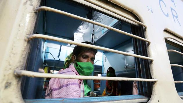 Migrant labourers who stranded in Nashik arrived at Misrod railway station on a special train, in Bhopal on Saturday.(ANI)