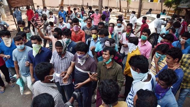 Andhra Pradesh, May 4, (ANI):Stranded migrant workers from other states arrive at the Mandal RevenueOffice, to ask theofficials to make arrangements for their transportationto go to their native places, during theongoing COVID-19 nationwide lockdown, in Vijayawada.(ANI)