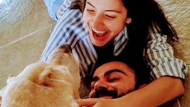 Virat Kohli and Anushka Sharma with their pet dog Bruno.(Anushka Sharma/Instagram)