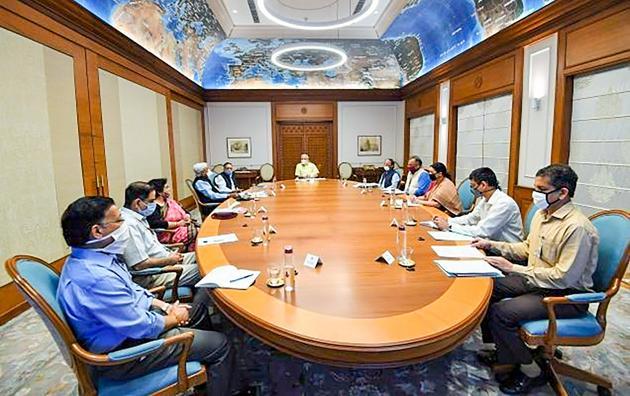 Prime Minister Narendra Modi chairs a meeting of the task force on coronavirus vaccine development in New Delhi.(@narendramodi/Twitter)