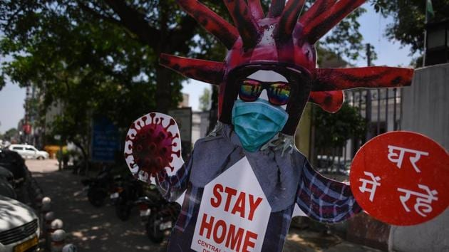 A cut-out urging people to stay at home during Covid-19 lockdown is seen at Daryaganj in New Delhi on Tuesday.(Biplov Bhuyan/HT Photo)