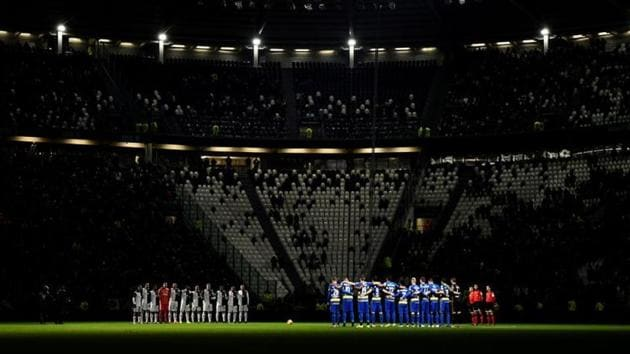 General view as the teams observe a minutes silence before the match.(REUTERS)