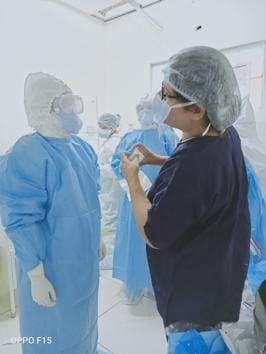 Seniors checking if the PPE kits have been worn properly at PGIMER in Chandigarh.(HT PHOTO)