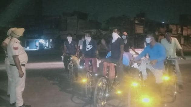 Riding cycles that cost them ₹4,200 each, the migrants will pedal 359 km to reach home to Moradabad in Uttar Pradesh.(HT Photo)