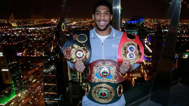 Anthony Joshua poses with the IBF, WBA, WBO & IBO World Heavyweight belts.(Action Images via Reuters)