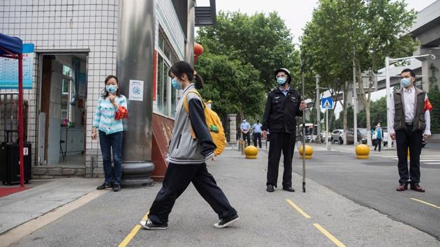 Senior school students returned to class on May 6 in the central Chinese city of Wuhan, where the coronavirus that has now swept the globe first emerged late last year.(AFP)