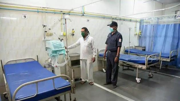A medical professional and security person wearing mask in view of coronavirus pandemic seen inside an isolation ward of NMMC hospital in Navi Mumbai.(PTI File Photo)