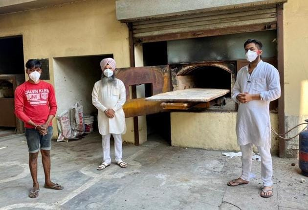 The two priests and helper who take care of last rites of Covid patients at the crematorium near Dholewal Military Complex in Ludhiana.(HT Photo)