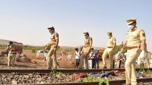Police personnel inspect the spot after a goods train ran over a group of migrant workers while they were sleeping on the tracks, in Aurangabad district, Friday, May 8, 2020. 14 migrants were killed in the tragedy. (PTI Photo) (PTI08-05-2020_000032B)(PTI)